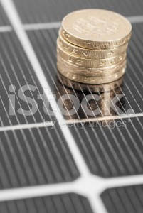 stock-photo-22991545-macro-pv-solar-panel-and-money-